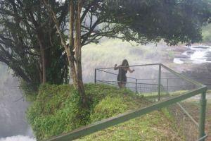 The woman struggling to climb Murchison Falls' muddy banks (me).