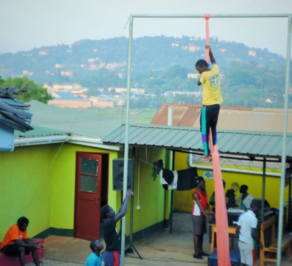 Instructions from the ground are called up to the aerialist as he practices his performance.